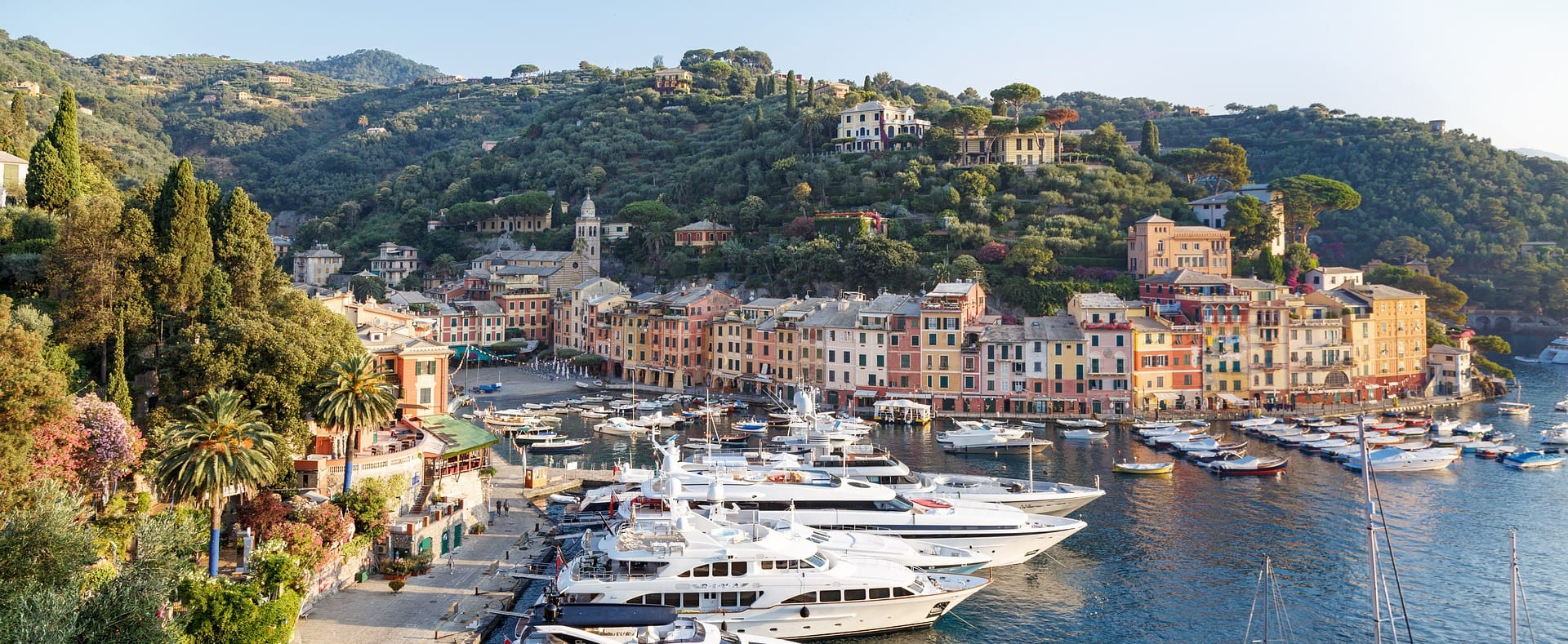 Aerial view of yachts and apartment buildings at Portofino fishing village and holiday resort, Italy.