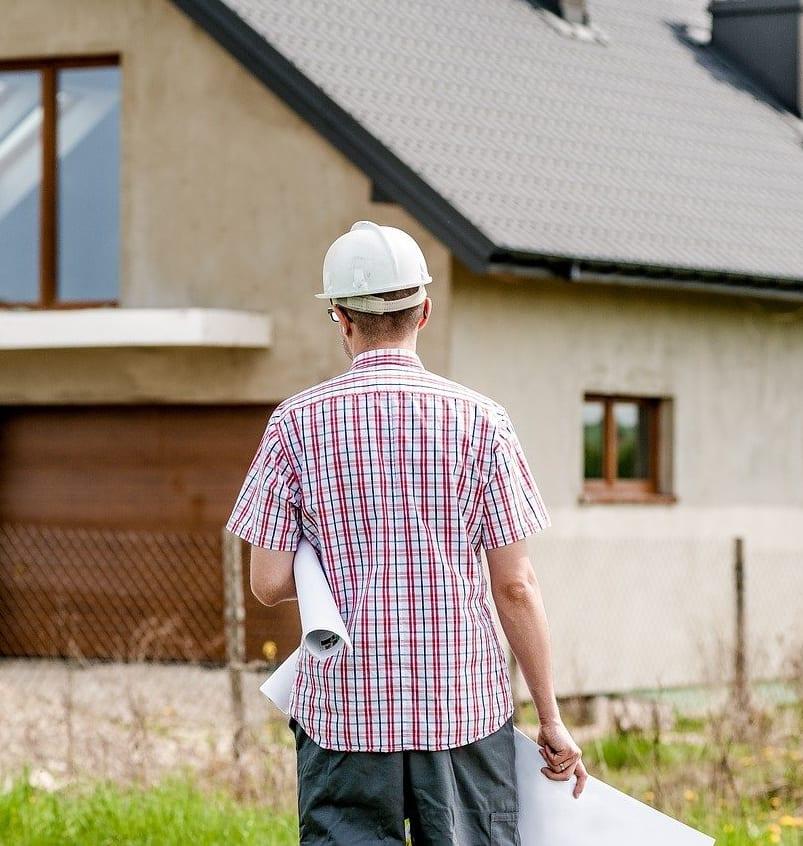 Architect Approaching House